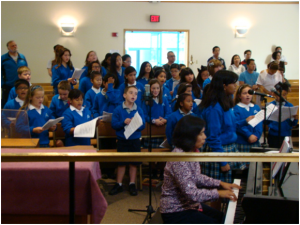 St. Justin School Choir led by Lillian Kwiatkowski, our Parish Music Director singing at our all-school Mass.