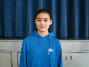 St. Justin School champion Cailey Larmore, 6th Grade, spelling the word 'Freudian' in the final round.